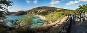 Hanauma Bay Nature Preserve is a popular snorkeling area run by the City and County of Honolulu, in the Hawaii Kai neighborhood, on the island of Oahu, Hawaii, USA. After decades of overcrowding, Hanauma Bay is now better managed as the first Marine Life Conservation District in the State, which attempts to sustain the stressed reef which hosts a great variety of tropical fish. Feeding the fish is no longer allowed and the park is closed on Tuesdays to allow the fish a day of rest undisturbed. Hanauma Bay formed within the tuff ring of an eroded volcanic crater along the southeast coast of Oahu. This image was stitched from multiple overlapping images.