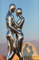 SENTIENT AI by: Michael Benisty, Love and Unity from: Brooklyn, NY year: 2018<br /> <br /> A sculptural representation of Male and Female holding one another in a symbolic and universal position of caring in a display of Love and Unity. Measuring 25 feet tall and made out of mirror polished stainless steel. URL: http://www.michaelbenisty.com Contact: benistyart@gmail.com