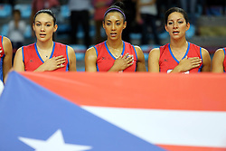 Vilmarie Mojica and Aurea Cruz listen to Puerto RIco national anthem