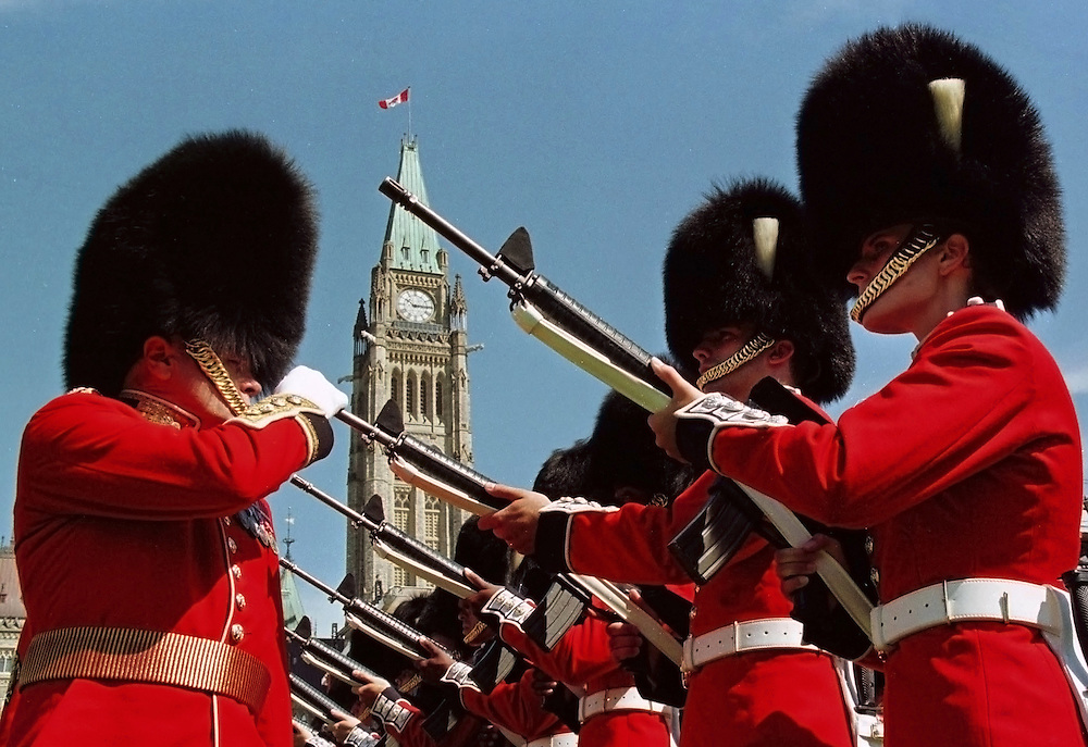 A Footguard inspects a rifle barrel during the changing of the guard ceremony at the Canada Day celebrations on Parliament Hill in Ottawa, July 1, 1999. REUTERS/Jim Young