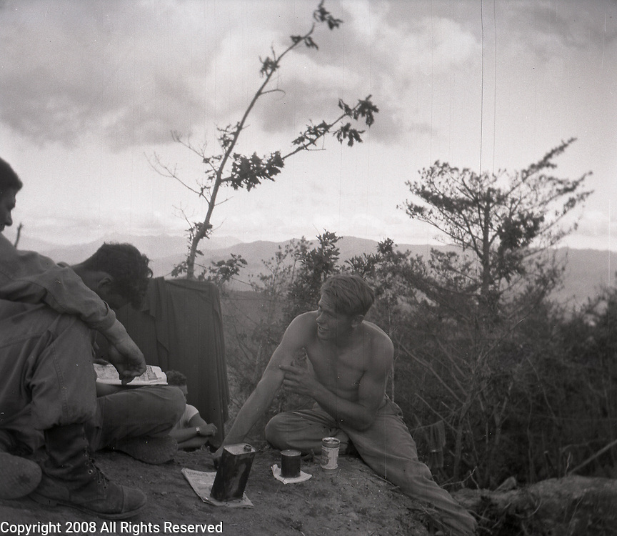 Soldiers of the Second Infantry Division take a moment to relax during the Korean War. Two soldiers talk while another reads a newspaper. These are photos of the 2nd Infantry Division in the Korean War in 1950 or 1951.