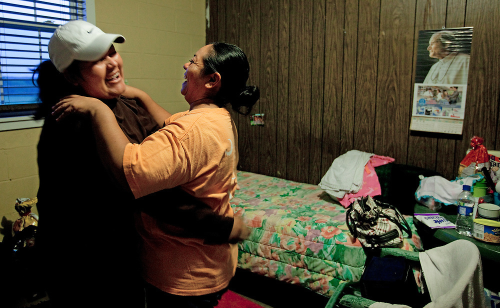Roommates have fun as they dance in their room.