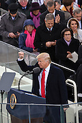 President Donald Trump holds up his fist in victory following  his Inaugural address after taking the oath of office to become the 45th President of the United States of America on Capitol Hill January 20, 2017 in Washington, DC.