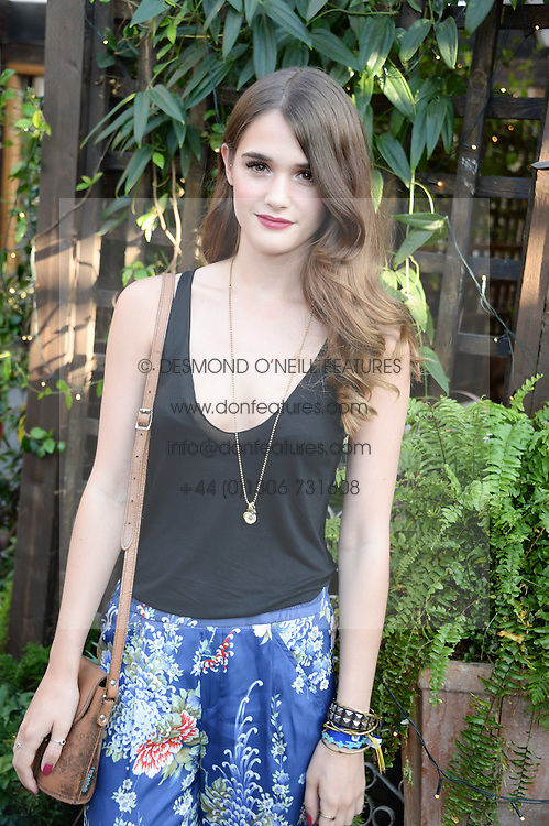 SAI BENNETT attending the Warner Bros. & Esquire Summer Party held at Shoreditch House, Ebor Street, London E1 on 18th July 2013.