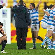 Jubilation for Argentina and dejection for Nick De Luca, Scotland (left) as Argentina celebrate their 13-12 during the Argentina V Scotland, Pool B match at the IRB Rugby World Cup tournament. Wellington Regional Stadium, Wellington, New Zealand, 25th September 2011. Photo Tim Clayton...
