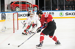Kevin Lalande of Belarus vs Vincent Praplan of Switzerland during the 2017 IIHF Men's World Championship group B Ice hockey match between National Teams of Switzerland and Belarus, on May 10, 2017 in AccorHotels Arena in Paris, France. Photo by Vid Ponikvar / Sportida