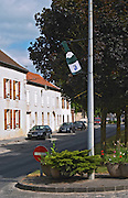 In front of the winery in the village Ay a sign made of a bottle of champagne marked with Ay and the main street in the village Champagne house Maison Giraud-Hemart, also called Champagne Henri Giraud, Ay, Vallée de la Marne, Champagne, Marne, Ardennes, France