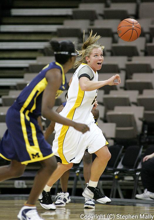 08 February 2007: Iowa forward Krista VandeVenter (51) go after a lose ball in Iowa's 66-49 win over Michigan at Carver-Hawkeye Arena in Iowa City, Iowa on February 8, 2007.