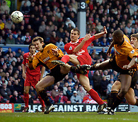 Photo. Jed Wee.<br /> Liverpool v Wolverhampton Wanderers, FA Barclaycard Premiership, Anfield, Liverpool. 20/03/2004.<br /> Liverpool's Michael Owen (C) volleys a shot over the bar from 6 yards out late in the game.