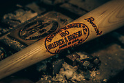 A bat is branded with the Hillerich and Bradsby logo at the Louisville Slugger Museum.