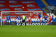 Millwall's Shaun Hutchinson (4) and Cardiff City's Captain Sean Morrison (4) compete for a high ball during the EFL Sky Bet Championship match between Cardiff City and Millwall at the Cardiff City Stadium, Cardiff, Wales on 30 January 2021.