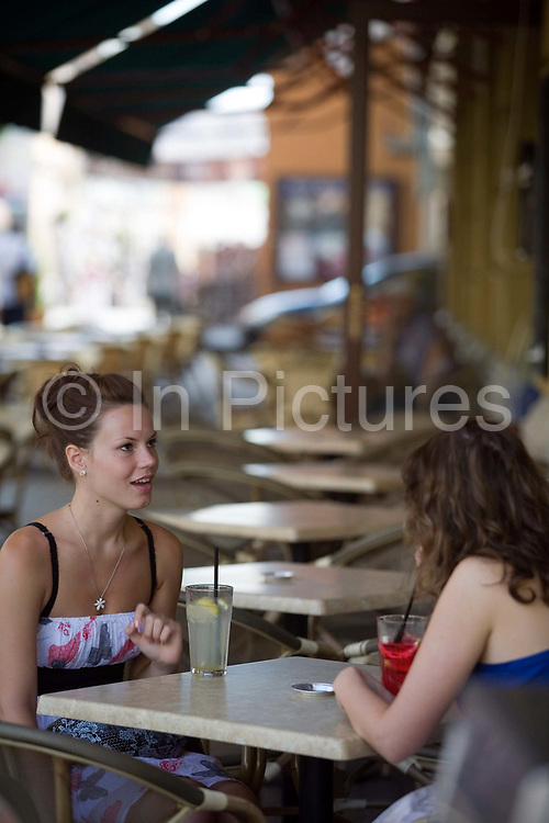 Two girls sitting outside a cafe drinking fruit cocktails , Pecs, hungary.Pecs has been chosen as the 2010 European City of Culture.Pecs has been chosen as the 2010 European City of Culture. The city is on the southern slopes of the Mecsek Hills and has a sub-Mediterranean climate. Settled by Romans as Sopianae, it was a significant Christian settlement. Later conquered by the Ottomans, it has important Turkish architecture.Two girls sitting outside a cafe drinking fruit cocktails , Pecs, Hungary.Pecs has been chosen as the 2010 European City of Culture. The city is on the southern slopes of the Mecsek Hills and has a sub-Mediterranean climate. Settled by Romans as Sopianae, it was a significant Christian settlement. Later conquered by the Ottomans, it has important Turkish architecture.