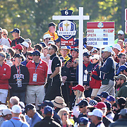 Ryder Cup 2016. Day Two. The scoreboard placard carrier surrounded by fans on the sixth during the Saturday morning foursomes during the Ryder Cup at the Hazeltine National Golf Club on October 01, 2016 in Chaska, Minnesota.  (Photo by Tim Clayton/Corbis via Getty Images)