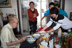 April 24, 2018 - Taiyuan, Taiyuan, China - Taiyuan, CHINA-24th April 2018: Richard Connell teaches pupils English at his rented apartment in Taiyuan, north China's Shanxi Province. The 85-year-old retired professor Richard Connell has been teaching students English for free in China for two years. Richard says that he likes Chinese culture and wants to help more people. (Credit Image: © SIPA Asia via ZUMA Wire)