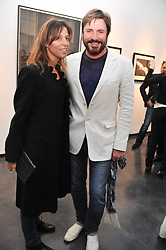 SIMON LE BON and GALA PRATT at a private view of photographs by Herb Ritts held at Hamiltons Gallery, 13 Carlos Place, London on 21st June 2011.
