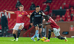 MANCHESTER, ENGLAND - Friday, January 1, 2020: Manchester United's Scott McTominay (L) and Aston Villa's Matthew Cash during the New Year's Day FA Premier League match between Manchester United FC and Aston Villa FC at Old Trafford. The game was played behind closed doors due to the UK government putting Greater Manchester in Tier 4: Stay at Home during the Coronavirus COVID-19 Pandemic. (Pic by David Rawcliffe/Propaganda)