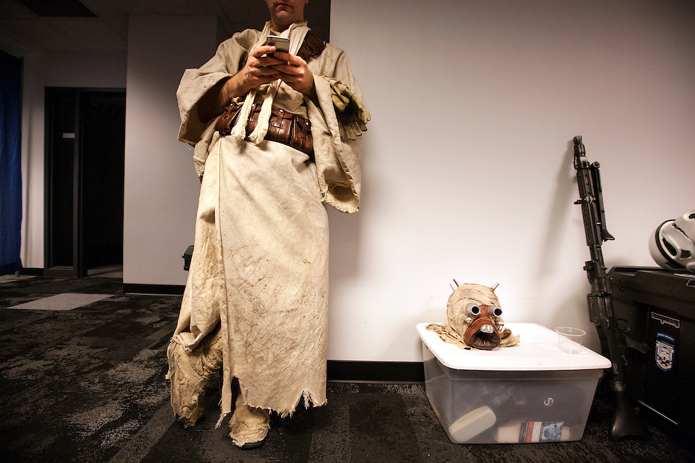 Matt Rolfe of Plymouth takes a break from being a Tusken Raider to check his phone at Star Wars night at the Timberwolves game at Target Center in Minneapolis December 15, 2015.