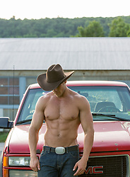 sexy shirtless cowboy leaning against a truck