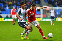 Bolton Wanderers' Adam Chicksen vies for possession with Fleetwood Town's Lewis Coyle<br /> <br /> Photographer Richard Martin-Roberts/CameraSport<br /> <br /> The EFL Sky Bet League One - Bolton Wanderers v Fleetwood Town - Saturday 2nd November 2019 - University of Bolton Stadium - Bolton<br /> <br /> World Copyright © 2019 CameraSport. All rights reserved. 43 Linden Ave. Countesthorpe. Leicester. England. LE8 5PG - Tel: +44 (0) 116 277 4147 - admin@camerasport.com - www.camerasport.com