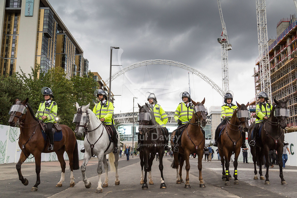 London, August 20 2017. Mounted police await the tide of fans as the game draws to a close when Tottenham Hotspur host their first game of the Premier League season at their temporary home ground, Wembley Stadium, hosting Chelsea FC, which saw the visitors win 1-2. © Paul Davey.