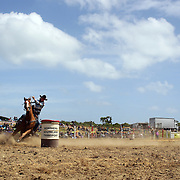 Henrietta Purvis from Waianakaru in action during the Open Barrel Race at the Southland Rodeo, Invercargill,  New Zealand. 29th January 2012