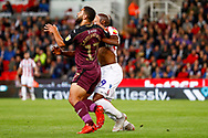 Swansea City defender Cameron Carter-Vickers (17), on loan from Tottenham Hotspur,  challenges Stoke City forward Benik Afobe (9) on loan from Wolverhampton Wanderers during the EFL Sky Bet Championship match between Stoke City and Swansea City at the Bet365 Stadium, Stoke-on-Trent, England on 18 September 2018.