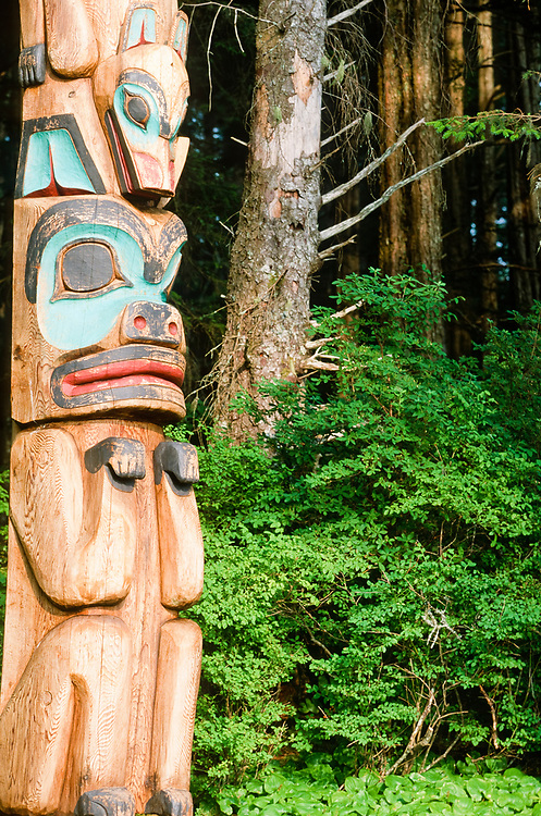 Alaska. Sitka. Southeast. Inside Passage. Sitka Totem Park. Native carved totem poles line the totem park for locals and tourists to enjoy, while walking through the cool temperate rainforest.