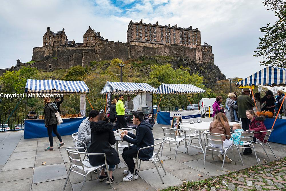 View of Weekend Farmers Market at foot of Edinburgh Castle in Scotland , United Kingdom.
