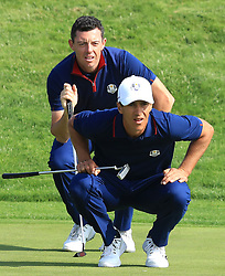 Team Europe's Rory McIlroy (back left) and Thorbjorn Olesen line up a putt on the sixteenth green during the Fourballs match on day one of the Ryder Cup at Le Golf National, Saint-Quentin-en-Yvelines, Paris.