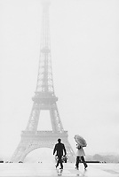 The Eiffel Tower in the rain - Photograph by Owen Franken
