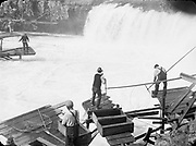 0805-M01. Indians with fish at Celilo Falls. 1936.