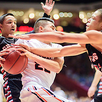 031215  Adron Gardner/Independent<br /> <br /> Grants Pirates Eric Rael (24), left, and Greg Harris (32) surround Gallup Bengal Richard Rangel (22) during a 5A New Mexico state basketball tournament semifinal at The Pit in Albuquerque Thursday.