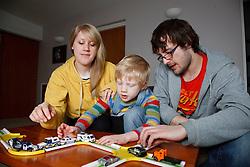 White family with toys.