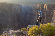 Obadiah Reid takes pictures from Island Peaks at sunset in Black Canyon of the Gunnison National Park, Colorado.