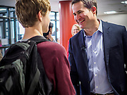 25 APRIL 2019 - DES MOINES, IOWA: US Representative SETH MOULTON (D-MA), greets students in the lobby of Central Academy. Rep. Moulton visited Central Academy in Des Moines Thursday to talk to high school students and the school's JROTC class about public service. Moulton, a US Marine veteran who served in Iraq, is running to be the Democratic candidate for the US Presidency in 2020. Iowa traditionally hosts the the first selection event of the presidential election cycle. The Iowa Caucuses will be on Feb. 3, 2020.             PHOTO BY JACK KURTZ