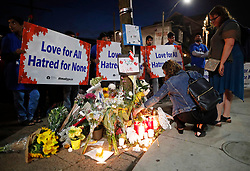 People place flowers and candles at a makeshift memorial remembering the victims of a shooting on Sunday evening on Danforth, Ave. in Toronto, ON, Canada, on Monday, July 23, 2018. Photo by Mark Blinch/CP/ABACAPRESS.COM