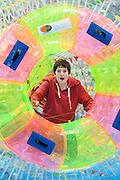 Children enjoy inflatable hamster wheels in th epool area. The London Boat Show opens at the Excel Centre, Docklands, London, UK 04 January 2014. Guy Bell, 07771 786236, guy@gbphotos.com