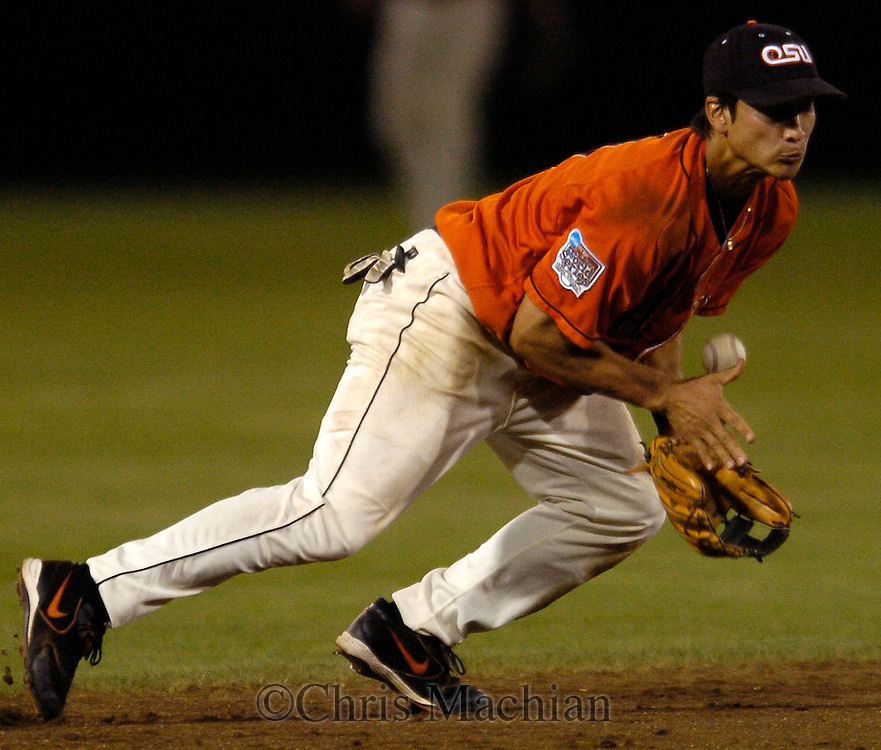 06/19/2006 Oregon State's Darwin Barney fields a ball that makes a bad hop but was able to recover and throw the runner out during game the second inning of game ten of the College World Series in Omaha Nebraska Tuesday evening..(photo by Chris Machian/Prairie Pixel Group)