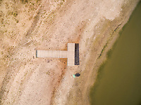 Aerial view above of single wood pier over a calm lake, Netherlands.