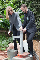 © Licensed to London News Pictures. 21/05/2012. London, England. Ringo Starr and his wife Barbara Bach pumping water at the Herbert Smith Garden for WaterAid. RHS Celsea Flower Show 2012 - Press Day. Photo credit: Bettina Strenske/LNP