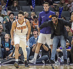 December 29, 2017 - Sacramento, CA, USA - Phoenix Suns guard Devin Booker (1) is celebrated by teammates as he helps keep the game against the Sacramento Kings out of reach on Friday, Dec. 29, 2017, at the Golden 1 Center in Sacramento, Calif. The Suns won, 111-101. (Credit Image: © Hector Amezcua/TNS via ZUMA Wire)