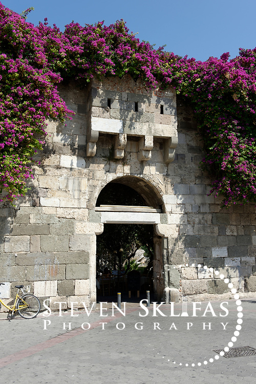 Gate of the Forum, one of the entrances into the old walled city in Kos town, the capital of the Greek island of Kos. Kos is part of the Dodecanese island group and birthplace of the ancient physician and father of medicine, Hippocrates. Please contact Steven Sklifas for more information.