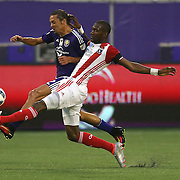 ORLANDO, FL - JUNE 18:  Shaun Francis #20 of San Jose Earthquakes and Adrian Winter #32 of Orlando City SC fight for the ball during an MLS soccer match between the San Jose Earthquakes and the Orlando City SC at Camping World Stadium on June 18, 2016 in Orlando, Florida. (Photo by Alex Menendez/Getty Images) *** Local Caption *** Shaun Francis; Adrian Winter