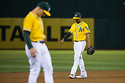 Oakland Athletics shortstop Marcus Semien (10) kicks dirt around during rough gameplay against the Los Angeles Angels at Oakland Coliseum in Oakland, California, on September 5, 2017. (Stan Olszewski/Special to S.F. Examiner)