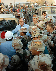 United States President George H.W. Bush shares a Thanksgiving holiday meal with US military personnel, U.S. Army 197th Infantry Brigade stationed during Operation Desert Shield, in Saudi Arabia on November 22, 1990. Photo by Ed Bailey / DoD via CNP/ABACAPRESS.COM