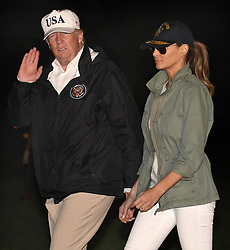 October 3, 2017 - Washington, District of Columbia, U.S. - United States President DONALD TRUMP cups his ear as a reporter shouts a question on gun control as he and First Lady MELANIA TRUMP return to the White House after a day trip to Puerto Rico where he viewed and was briefed on the Hurricane Irma devastation. (Credit Image: © Mike Theiler/CNP via ZUMA Wire)