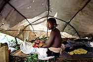 A woman who gave birth while fleeing the LRA holds her newly born baby in a makeshift tent near a road in Yambio South Sudan. A spate of continuing LRA attacks in South Sudan has pushed thousands of familes to flee from their remote homes to larger towns and along roadsides to seek protection.