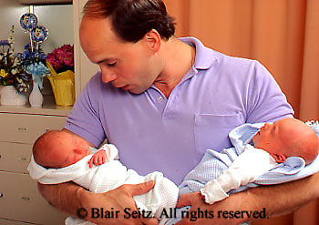 Medical, Hospital Maternity Ward, Father Holds Twin Babies,