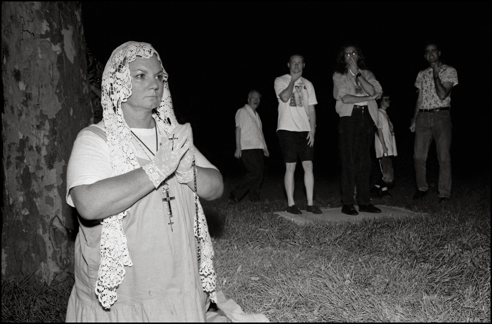 Pilgrims from around the world, devotees of Veronica Lueken, gather at the exedra monument at the 1964 New York World's Fair Vatican Pavilion site in Flushing Meadows Park, to pray for the world's salvation, witness miraculous healings and receive messages from the Virgin Mary and Jesus Christ.  <br /> <br /> Veronica Lueken was a Roman Catholic housewife from Bayside, New York, who, between 1970 until her death in 1995, reported experiencing apparitions of the Virgin Mary, Jesus, and numerous Catholic saints. She gave messages she claimed to have received from them at both the grounds of Saint Robert Bellarmine Catholic Church in Bayside, and  at the 1964 New York World's Fair Vatican Pavilion site.
