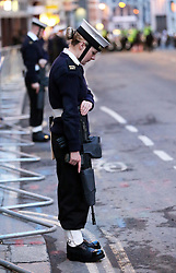 A servicewoman from the Royal Navy lines the streets for the early morning dress rehearsal for Baroness Thatcher's funeral held in London, Monday 15th April 2013 Photo by: Stephen Lock / i-Images